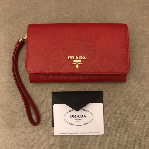 0d194a9fad94 NWOT Prada Saffiano Red Wristlet Wallet. M_5be6288dde6f62127229be06